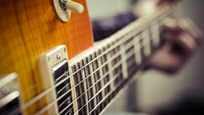 Close up photo of electric guitar. Electric guitar lessons for beginners offered at Friendly Frets Guitar Instruction, Everett, WA 98208.